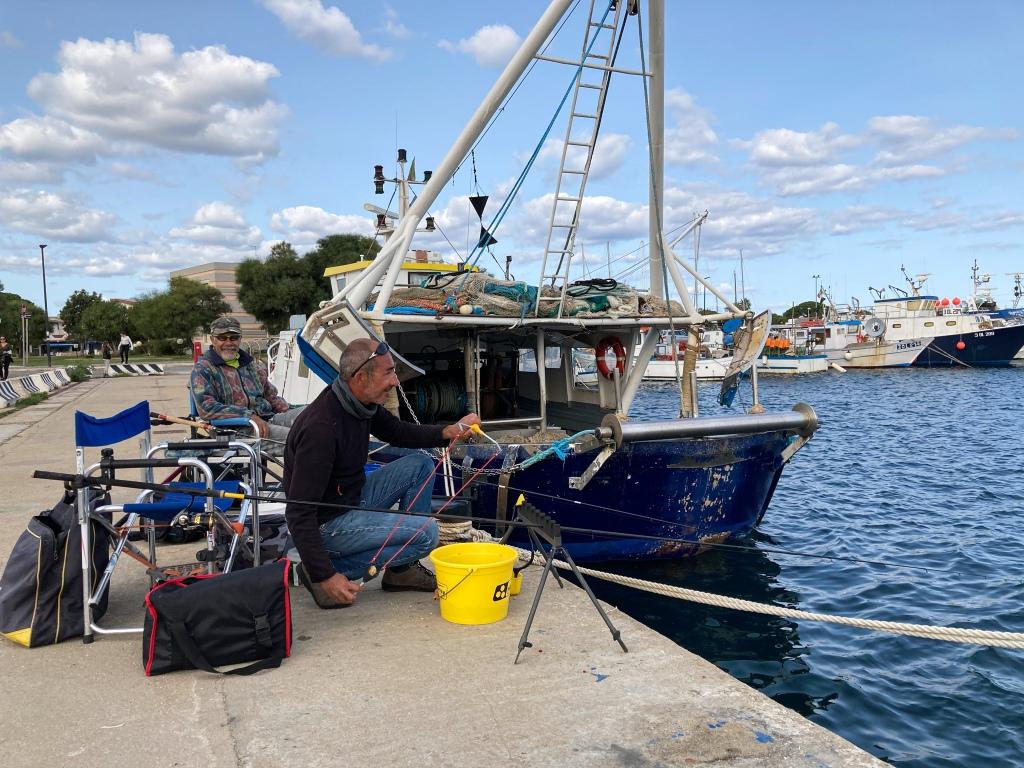 Fischer im Hafen von La Caletta